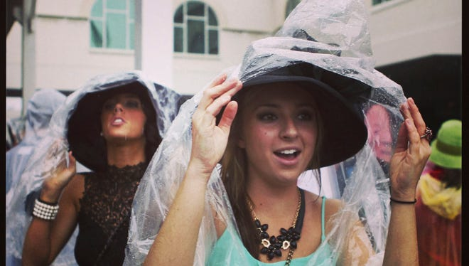 Rain ponchos were THE fashion accessory to have at the Kentucky Derby Saturday. (By Matt Stone, The Courier-Journal) May 4, 2013
