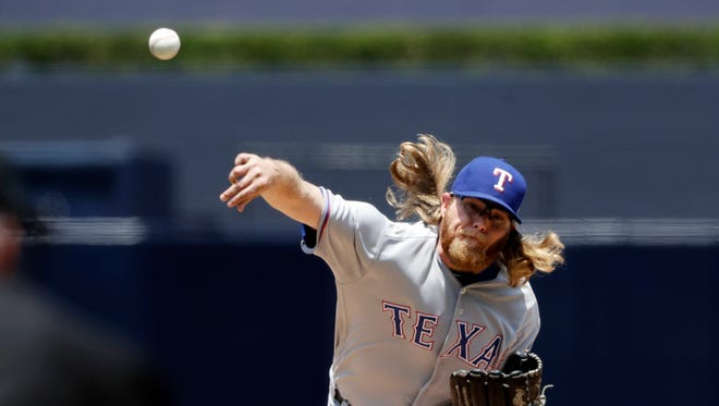 Texas Rangers starting pitcher A.J. Griffin works against a San Diego Padres batter during the first inning of a baseball game, Tuesday.