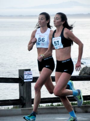 Twin sisters Erika, left, and Kathryn Fluehr compete at the Monterey Bay Half-Marathon in California on Nov. 11, 2017. The sisters, who both were individual state champions during their high school careers at Community School, are competing for the first time in the Naples Daily News Half Marathon on Sunday.