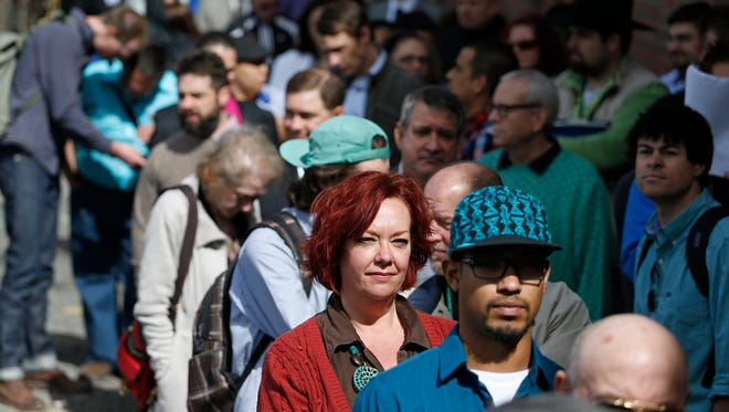 Job seekers line up to attend a marijuana industry job fair in downtown Denver.