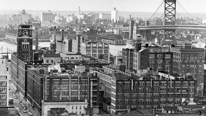 Photo showing the early Camden waterfront area with the RCA factories and Ben Franklin Bridge in front of the Philadelphia sky line.