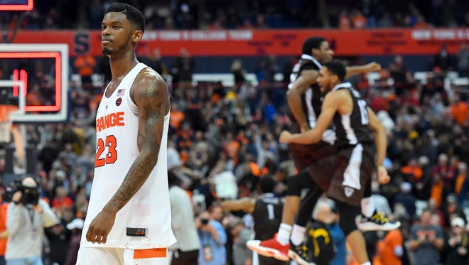 Syracuse Orange guard Frank Howard (23) reacts while walking off the court following the loss to the St. Bonaventure Bonnies at the Carrier Dome.