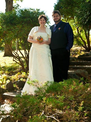 Kate Kompas, left, and Chris Shields pose for photos on Oct. 1, 2011.