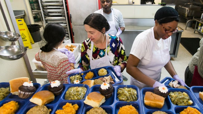 Volunteers plate food for a Thanksgiving meal at St. Joseph Diner in Lafayette Nov. 24, 2016. The program of Catholic led by Catholic Services of Acadiana offers essential services to preserve and enhance the lives of people experiencing poverty, hunger, and homelessness.