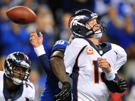 Denver Broncos quarterback Peyton Manning has the ball