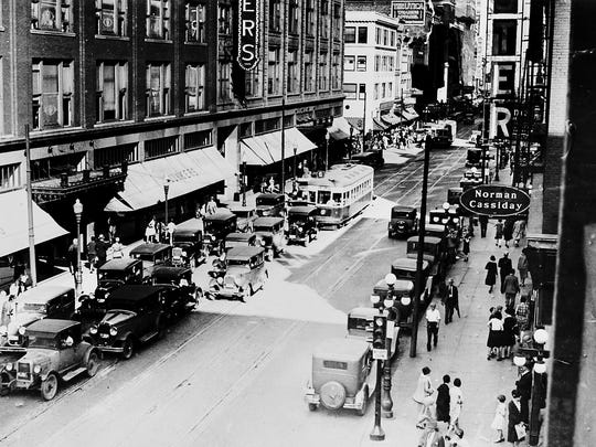 City leaders was to bring Walnut Street back to its glory days as a hub of commercial activity in downtown Des Moines. This photo, taken sometime between 1929 and 1932, shows Younkers Department Store, left, prior to the addition of the marquee covering the sidewalk, and the S.S. Kresge dime store (white building).