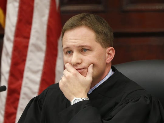 Judge Greg Pinski presides over a hearing in the 8th