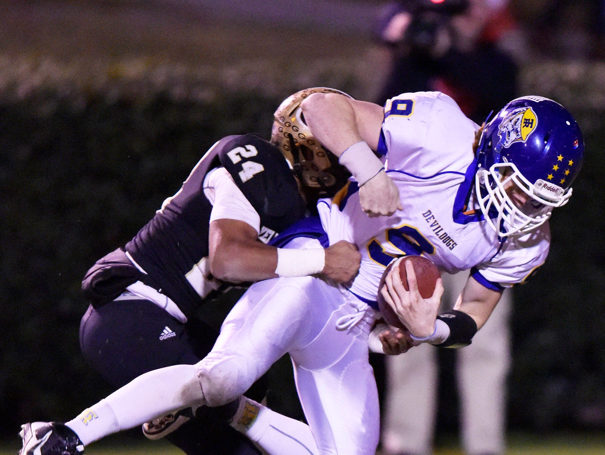 Travelers Rest's Chris Gomia (9) scores with Greer's Adrian McGee (24) in tow.