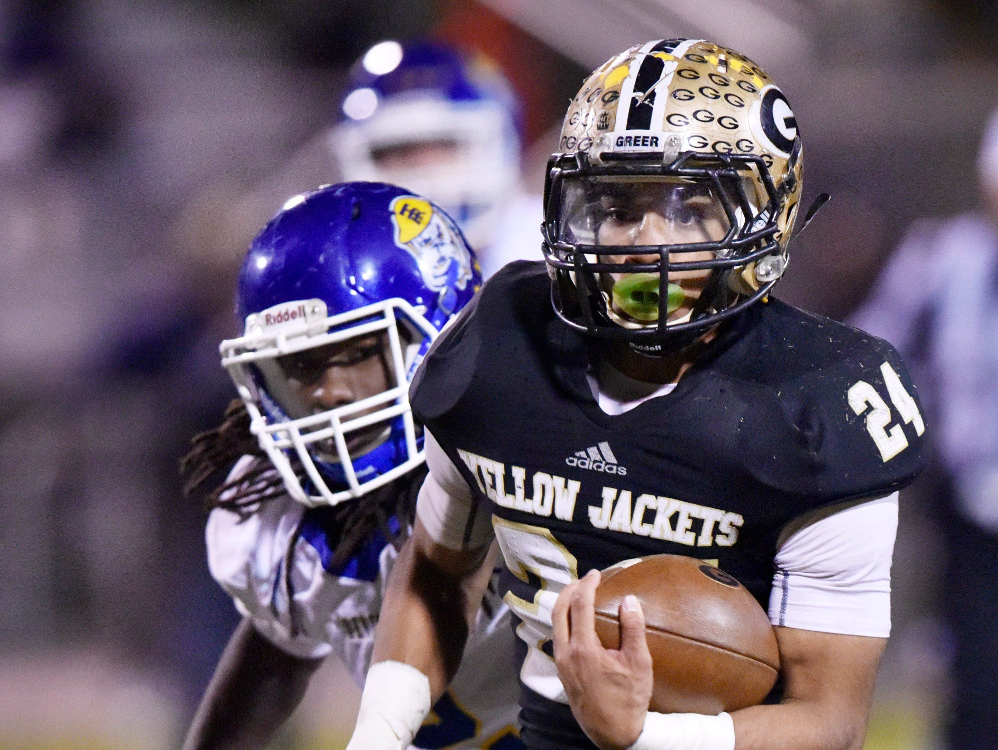 Greer's Adrian McGee (24) leaves Travelers Rest's defense on a touchdown run.