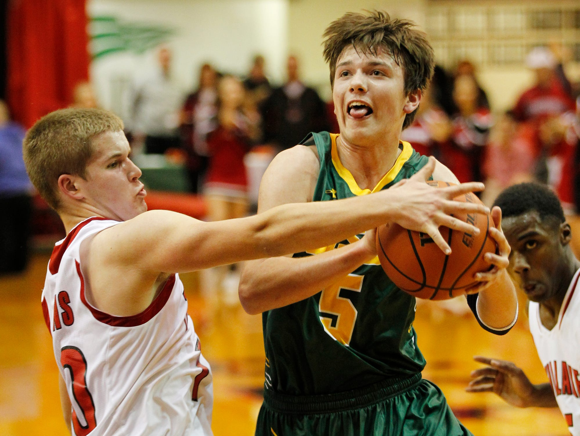 Bailey Rothrock of Twin Lakes strips the ball from Joey Waling of Benton Central in the J&C Hoops Classic Monday, November 30, 2015, at Jefferson High School. Twin Lakes thumped Benton Central 75-44.