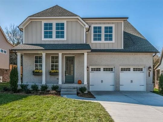 This four-bedroom Nolensville home is in the Bent Creek subdivision. Features include a fireplace, downstairs master suite, an attached two-car garage and a dining room.