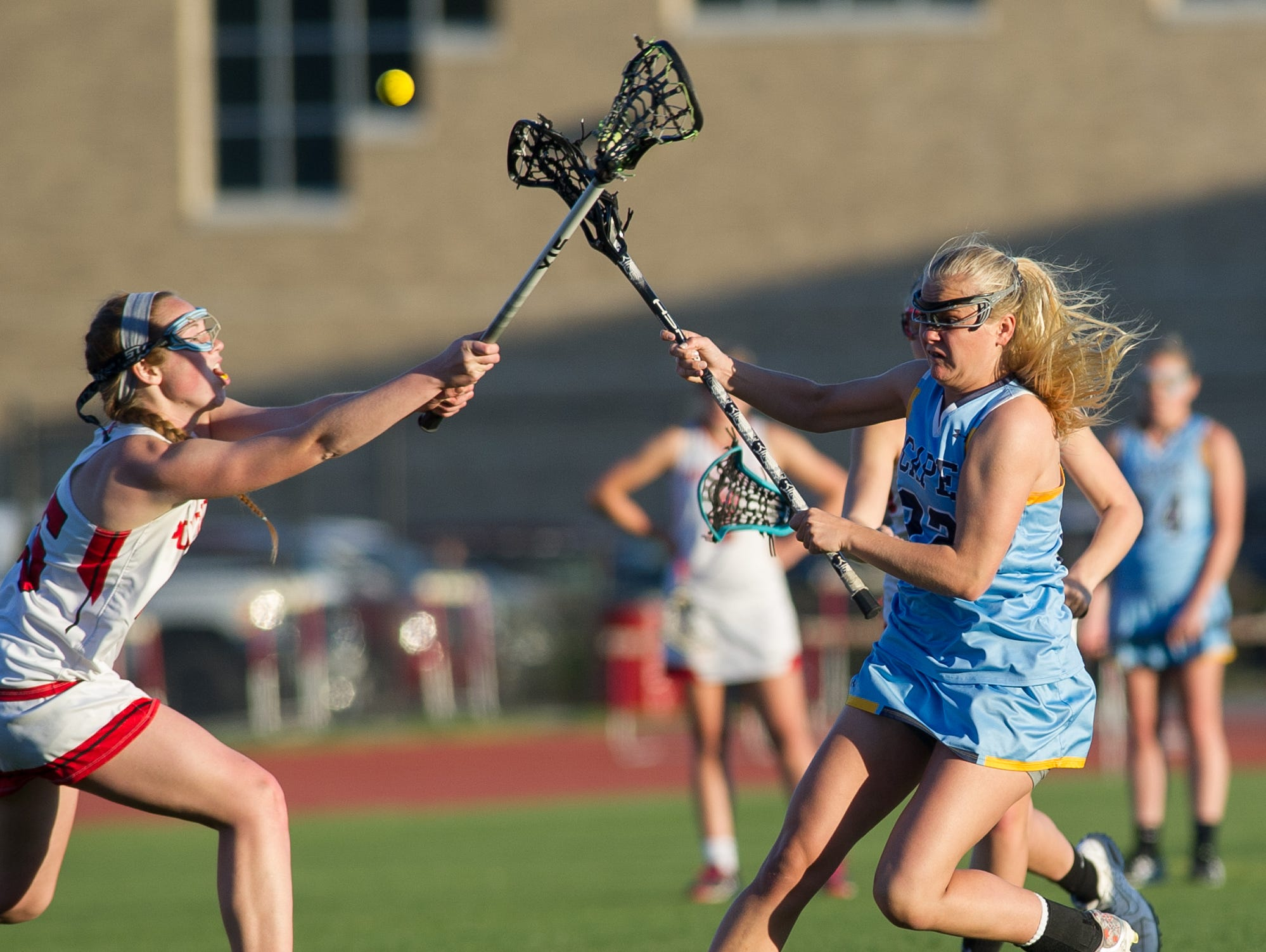Cape Henlopen's Evelyn Shoop (22) with a shot on goal in their 12-10 win over Polytech.