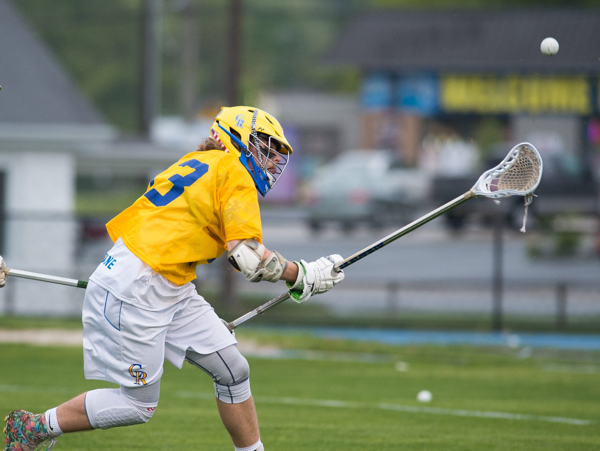 Caesar Rodney's Jacob Mollohan (33) runs after the ball in their home game against Tower Hill.