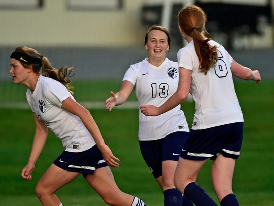 Shalom Christian's Lexy Poe (6) celebrates her goal in the MDCC championship game with teammate Sarah Priest (13). Poe was named the MDCC Player of the Year.