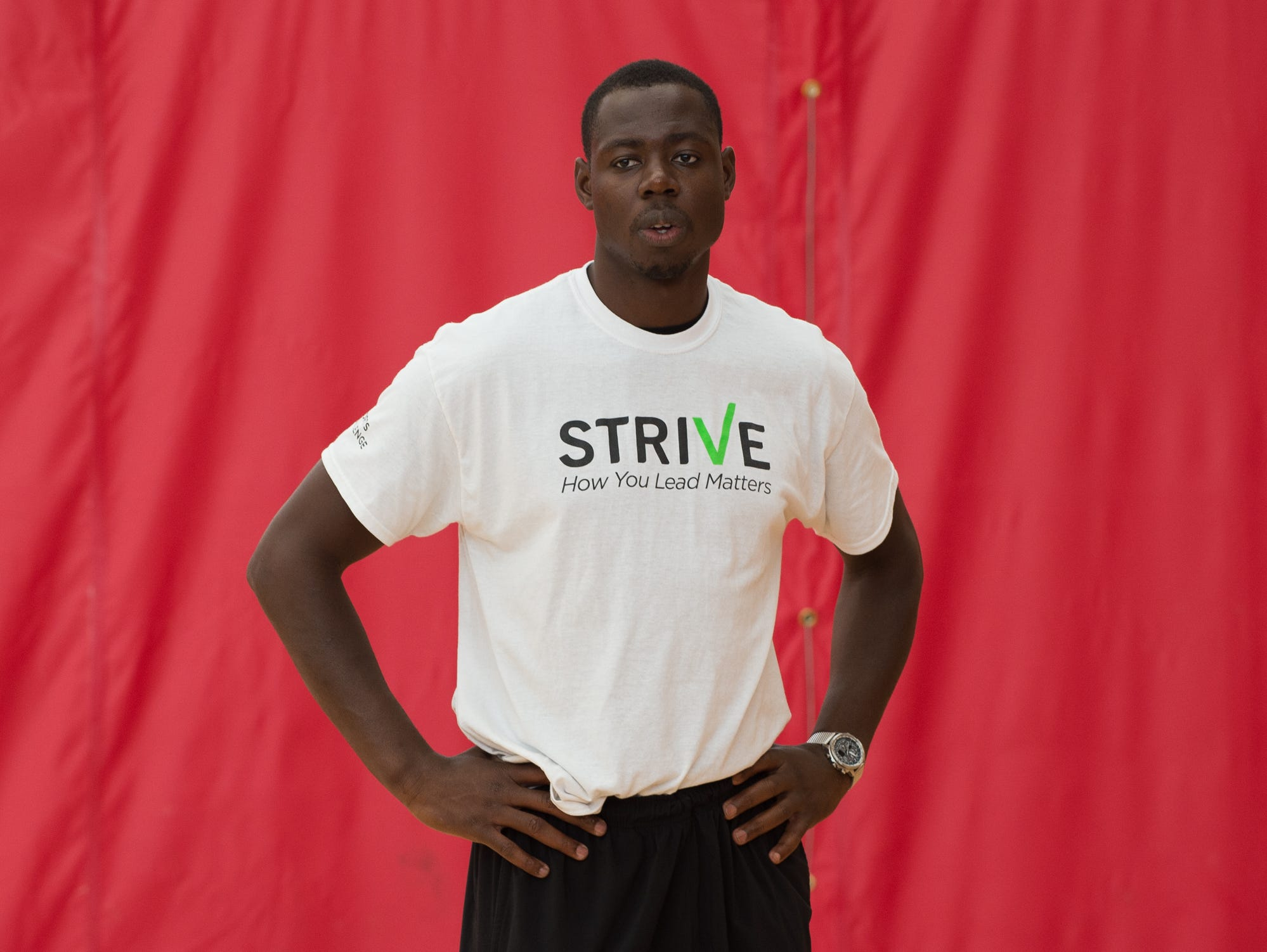 St. Andrew's School alumni, Eric Boateng, working with basketball players during the Strive Sports Challenge at St. Andrew's School in Middletown, Del,.
