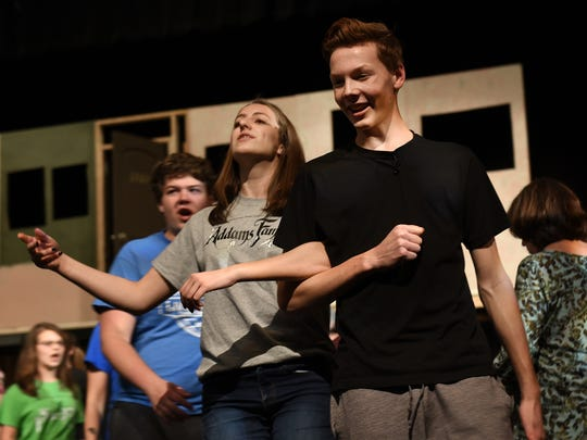 Milford High students Julia Schwendenmann and Cole Harvey rehearse a scene from the school's upcoming production of The Addams Family. The pair play Morticia and Gomez respectively.