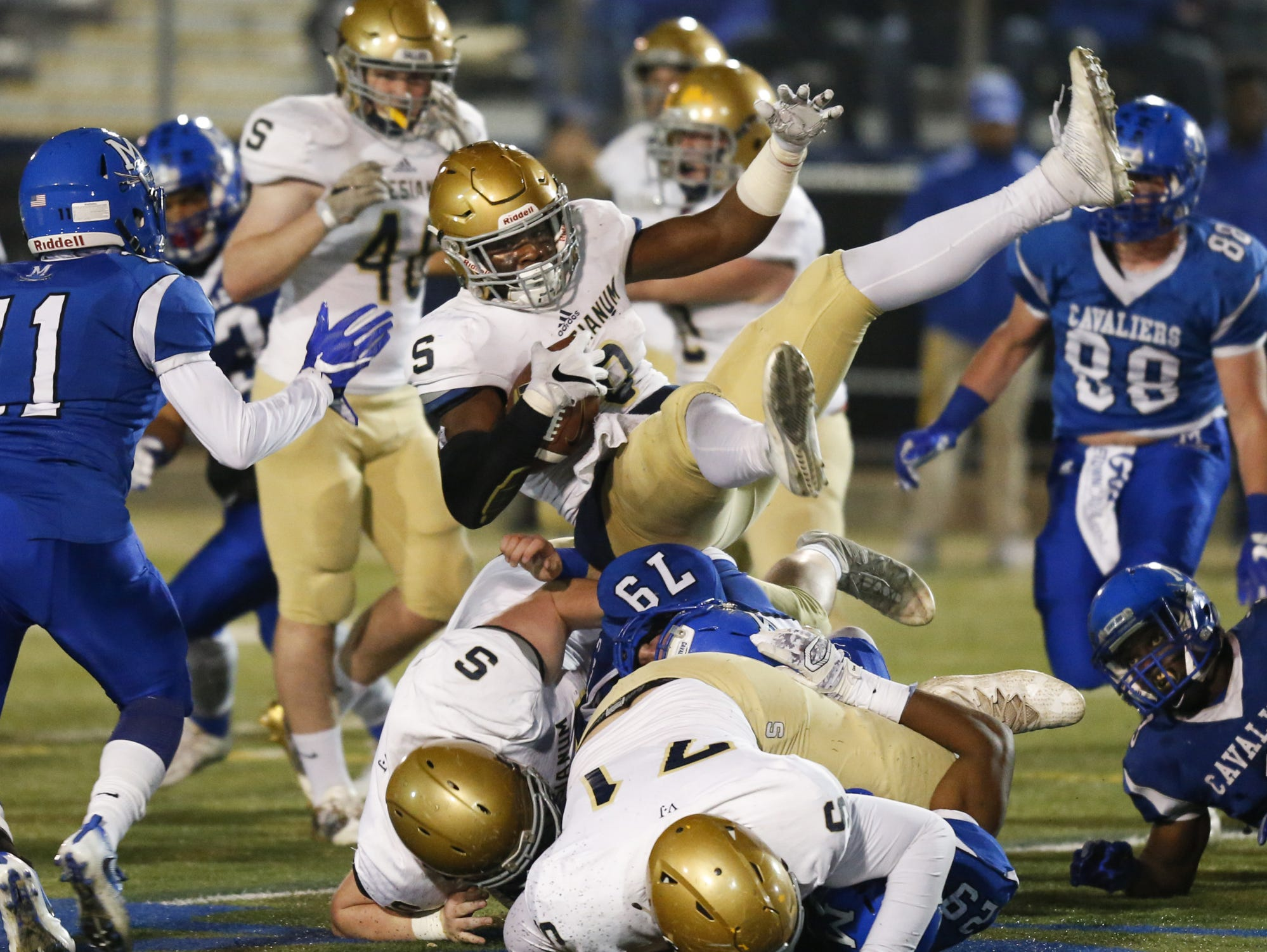 Salesianum's Josh Patrick is upended at the line on a run in the second quarter against Middletown in a DIAA Division I state tournament semifinal at Cavalier Stadium Friday.