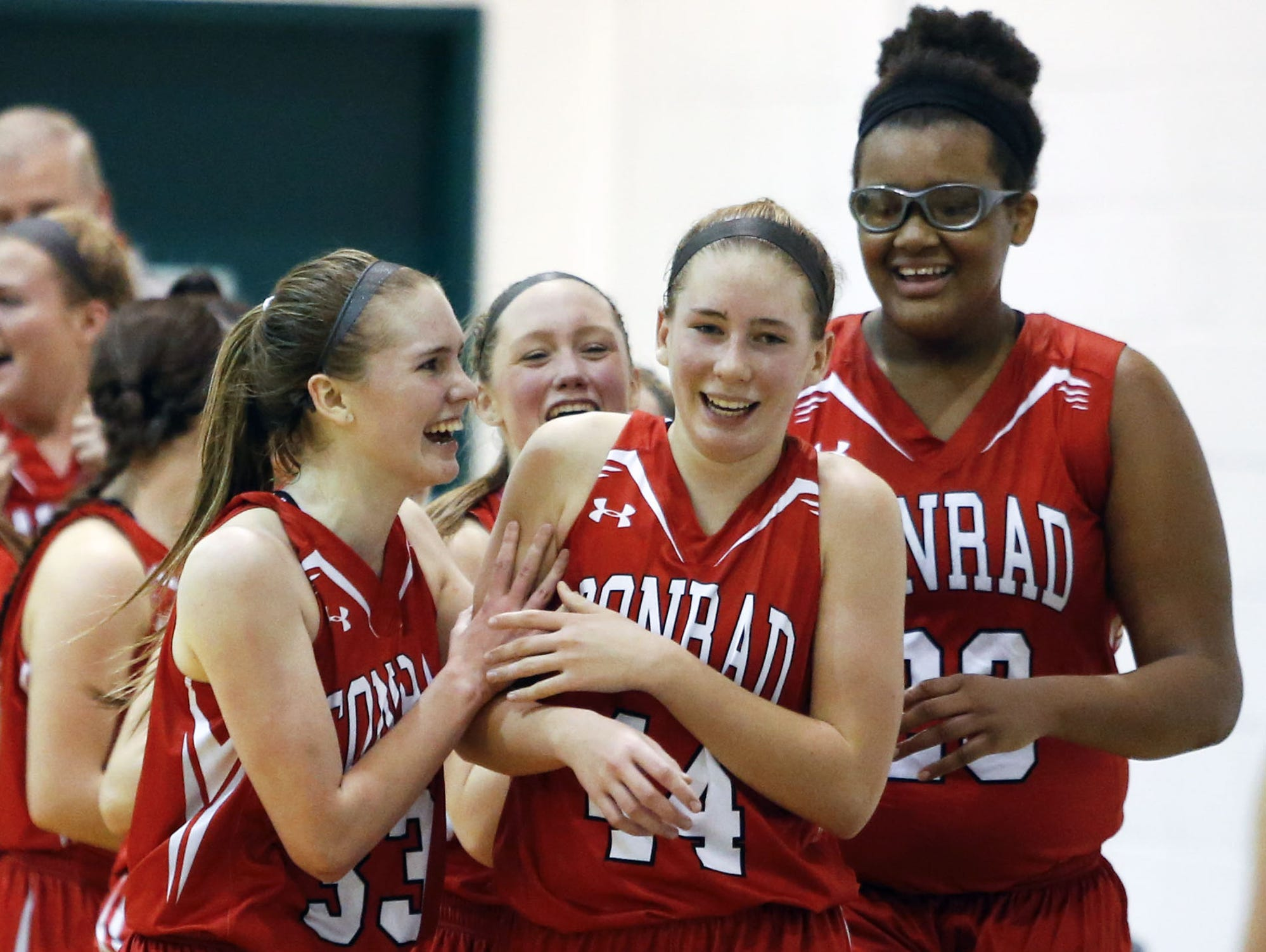 Conrad's Stefanie Kulesza (center) celebrates with Julie Kulesza (left) Ja'Nylah Whittlesey after she finished the game with a steal and layup at the buzzer for the difference in Conrad's 45-44 win at Archmere Tuesday.
