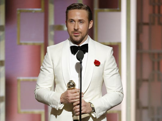 Ryan Gosling accepts the Golden Globe for best actor in a movie musical or comedy for 'La La Land.'