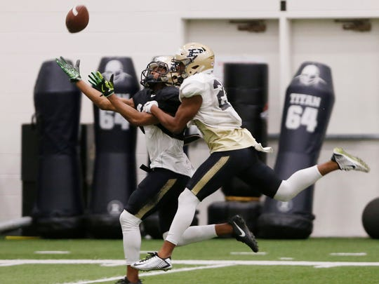 Cornerback Tim Cason defends wide receiver Gregory Phillips Purdue spring football practice Monday, March 27, 2017, inside the Mollenkopf Athletic Center.