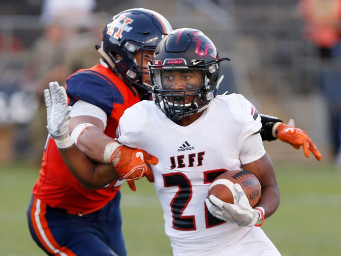 Lattrell Brown with a carry for Lafayette Jeff in the