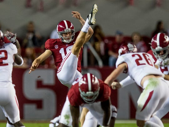 Alabama punter JK Scott (10) punts against Arkansas in first half action at Bryant Denny Stadium in Tuscaloosa, Ala. on Saturday October 14, 2017. (Mickey Welsh / Montgomery Advertiser)