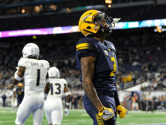 Toledo receiver Diontae Johnson celebrates his touchdown catch against Akron in the first quarter of the MAC championship game Saturday, Dec. 2, 2017 in Detroit.