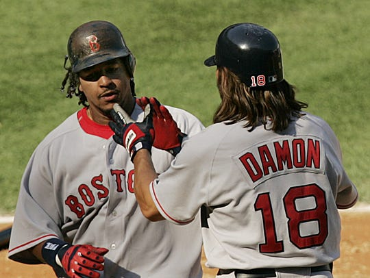 Boston Red Sox' Manny Ramirez, left, is greeted at