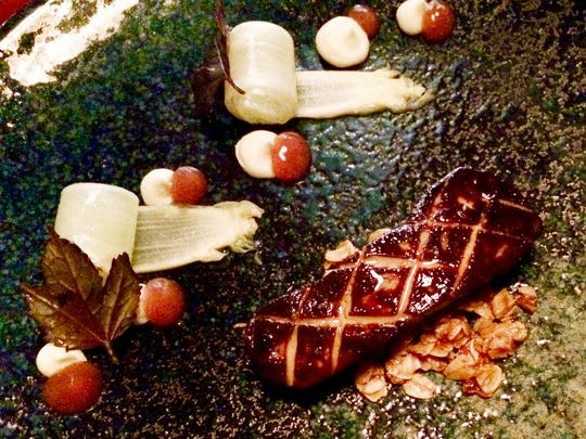 Seared foie gras, ginger, white asparagus curls and