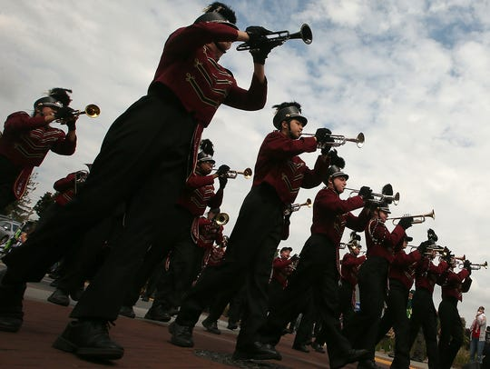 The South Kitsap High School Band marches in the Armed