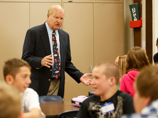 Fred Anderson, former North Middle School and Great Falls High principal, talks with students at North during class in 2012.
