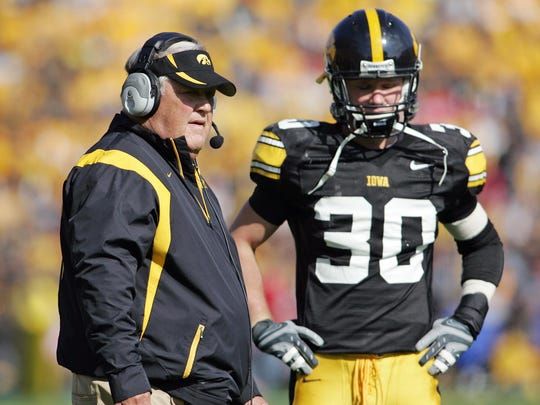 The late Norm Parker, left, was the architect of an Iowa defensive strategy that still works for the Hawkeyes to this day.
