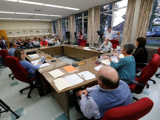 Endicott Village Trustees face a packed board room