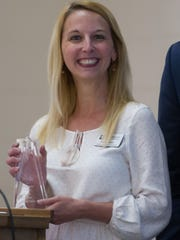 Jennie Bailey smiles as she receives her award for Kyndle's Ambassabor of the Year.