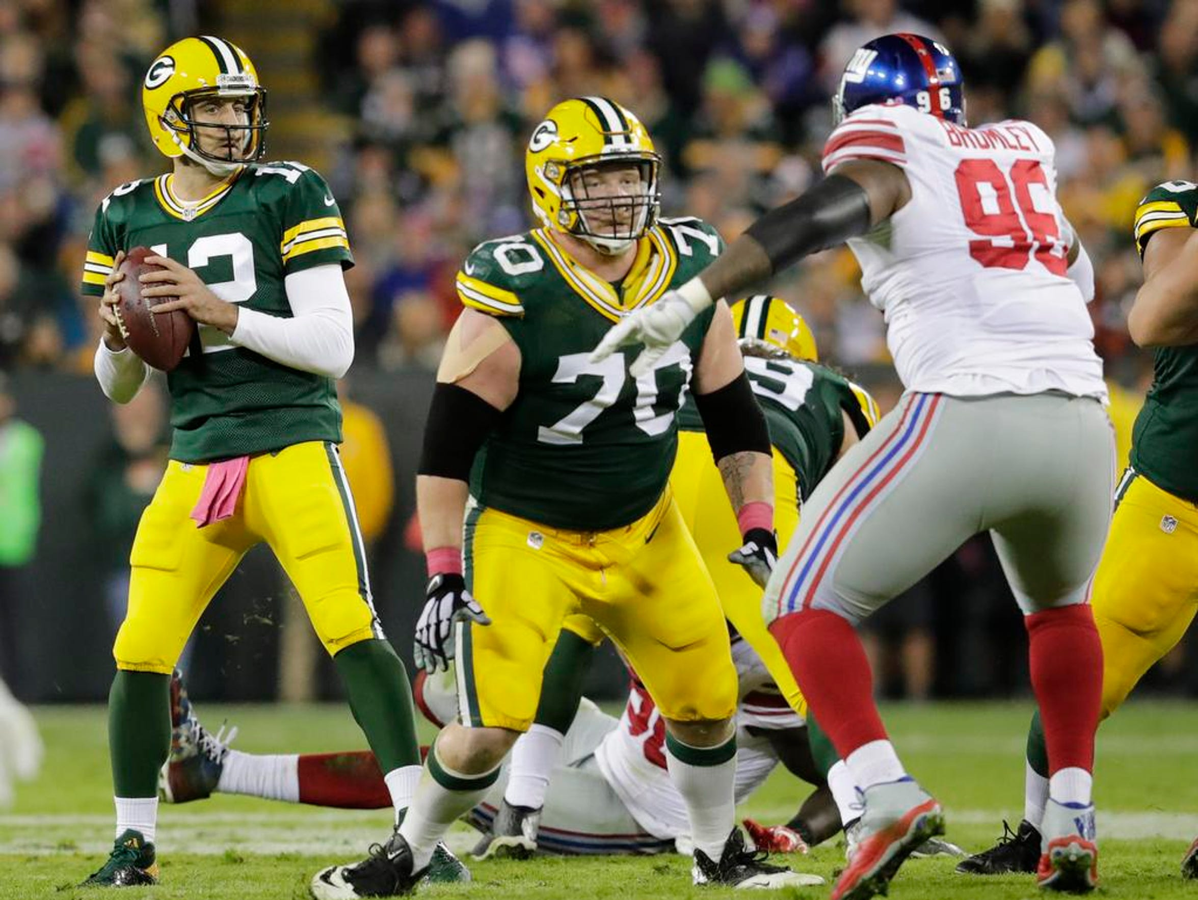 Green Bay Packers quarterback Aaron Rodgers looks to