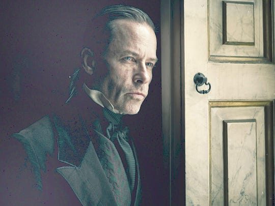"""Guy Pearce plays Ebenezer Scrooge in FX's new version of """"A Christmas Carol."""""""