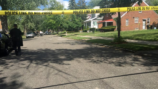 Police block off a section of Elmdale after two people were wounded, one fatally, in a drive-by shooting.