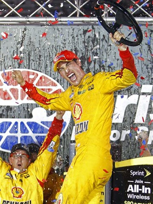 Joey Logano celabrates in Victory Lane after winning the NASCAR Sprint Cup Series auto race Saturday in Bristol, Tenn.