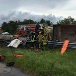 An overturned dump truck shut down northbound Interstate 95 in Titusville on Tuesday.