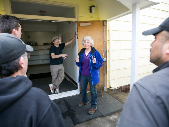 Vivian Ang talks to workers helping the Mid-Valley Literacy Center move to its new home on Wednesday.