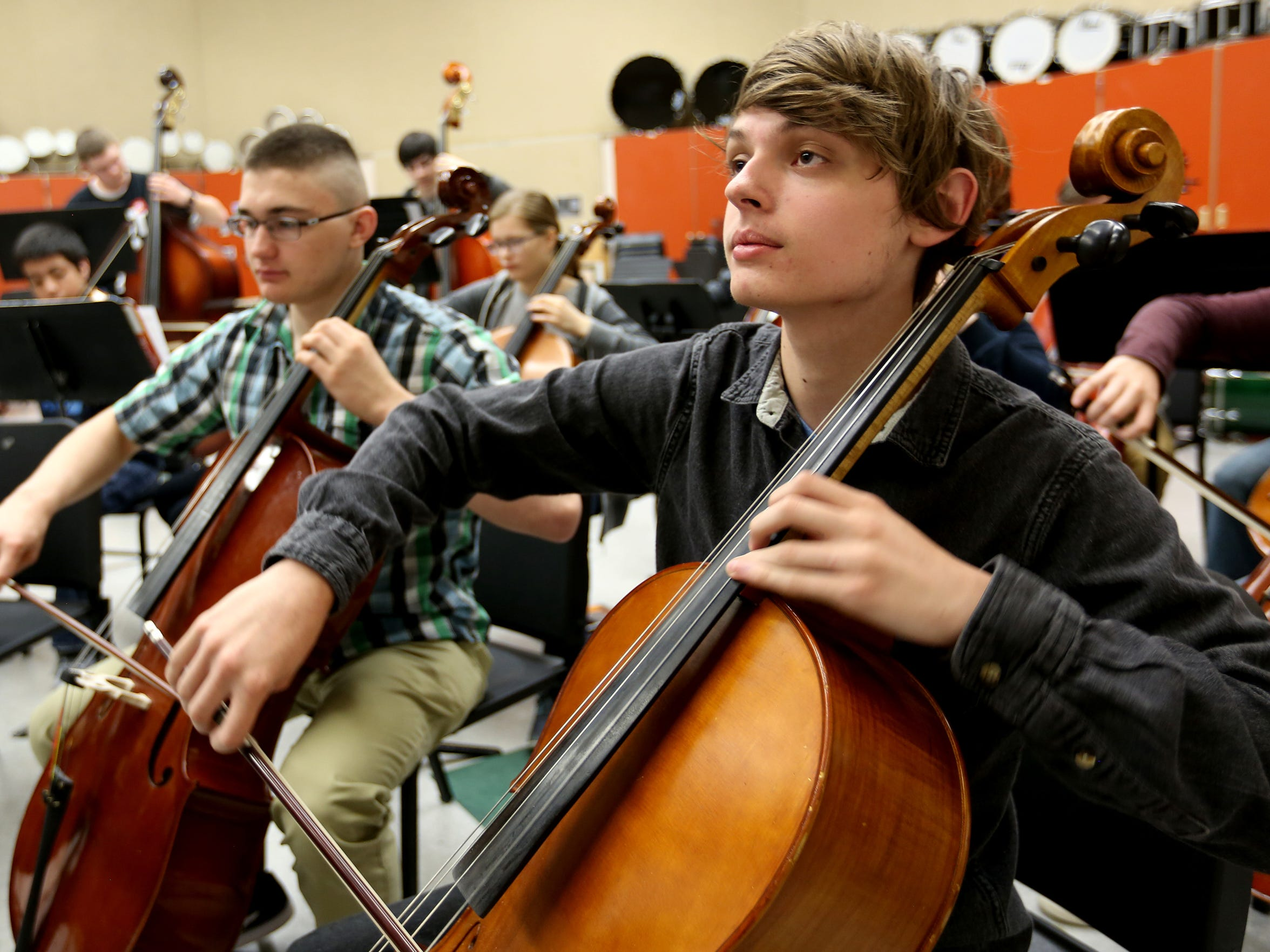"Trevor Fisher, a senior, plays first-chair cello in a chamber orchestra rehearsal at McKay High School in Salem on Thursday, April 14, 2016. He also plays in McKay's new symphony orchestra that will compete for a state championship May 12 in Corvallis. ""People should know that we're putting in the effort and we shouldn't be set aside compared to other schools,"" Fisher said."