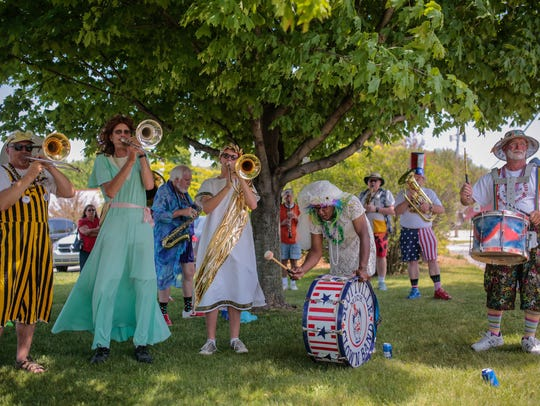 Members of the Scottville Clown Band warm up while