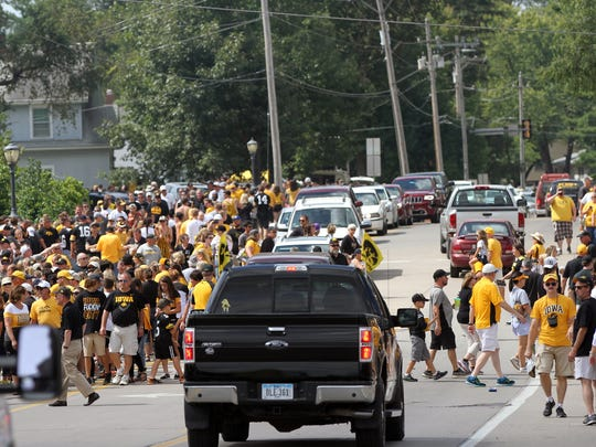 Football fans fill Melrose Avenue prior to the Hawkeyes' game against Miami (Ohio) at Kinnick Stadium on Saturday, Sept. 3, 2016.