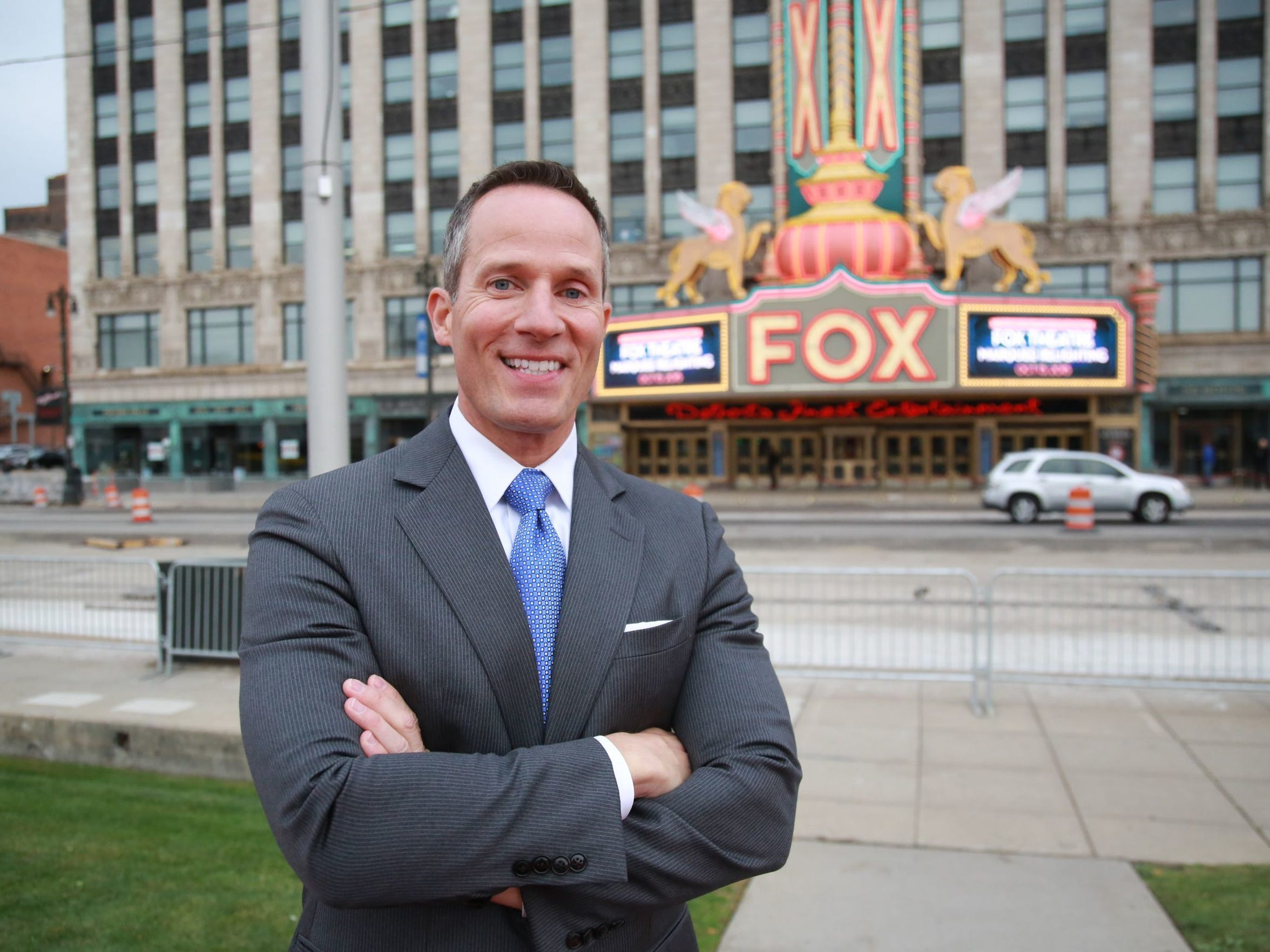 Chris Ilitch stands in front of the Fox Theatre marquee during the relighting event in Detroit on Oct. 15, 2015.