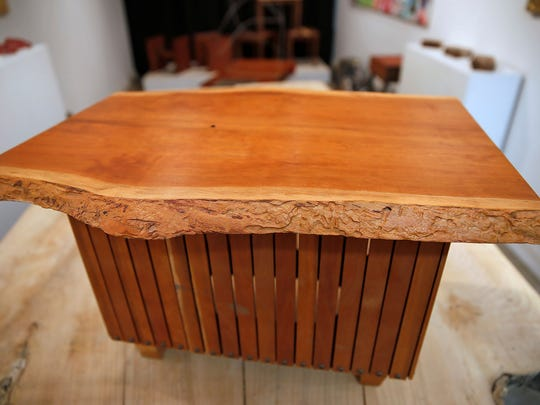 Here is coffee table that Brian Presnell made from the wood from downed or damaged trees.