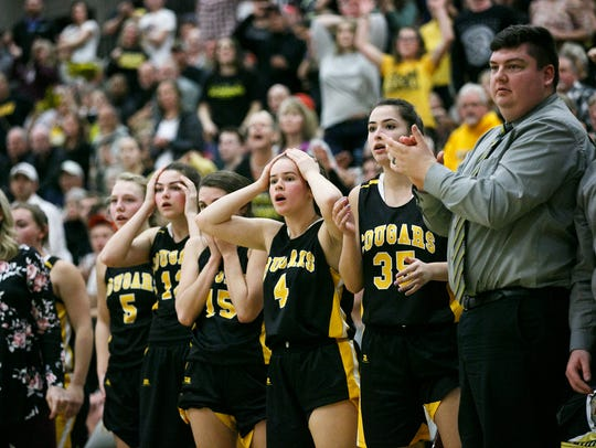 Cascade girls basketball reacts to a referee's foul