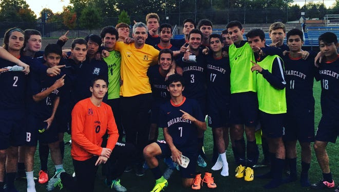 Briarcliff boys soccer coach Brandon Beck and his team celebrated his 100th career win after a 2-0 win at Blind Brook on Thursday, Oct. 13, 2016.