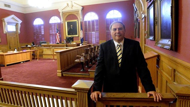 Commonwealth's Attorney Lee Ervin stands in the courtroom at the Augusta County Courthouse on Friday, Sept. 26, 2014.