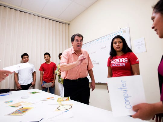Joe Payne, a teacher at the Literacy Council Gulf Coast in Bonita Springs teaches beginners english to students including Sebastiana Castaneda, right, and Estela Tomas, center, on Tuesday 9/23/2014.  The Cape Coral-Fort Myers metro area has had the fastest growth rate of workers with limited English proficiency among the largest metro areas, up 116 percent from 2000 to 2012.