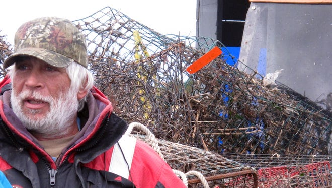 In this Feb. 26, 2016 photo, Robert Cericola, a commercial crabber, shows some of the 103 discarded crab traps he and others retrieved from Barnegat Bay in and around Waretown, N.J. in just one week. Efforts are under way around the world to remove discarded fishing equipment from waterways, where it can kill marine animals and present a hazard to navigation. (AP Photo/Wayne Parry)